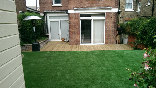 An artificial lawn before Willow Landscapes work